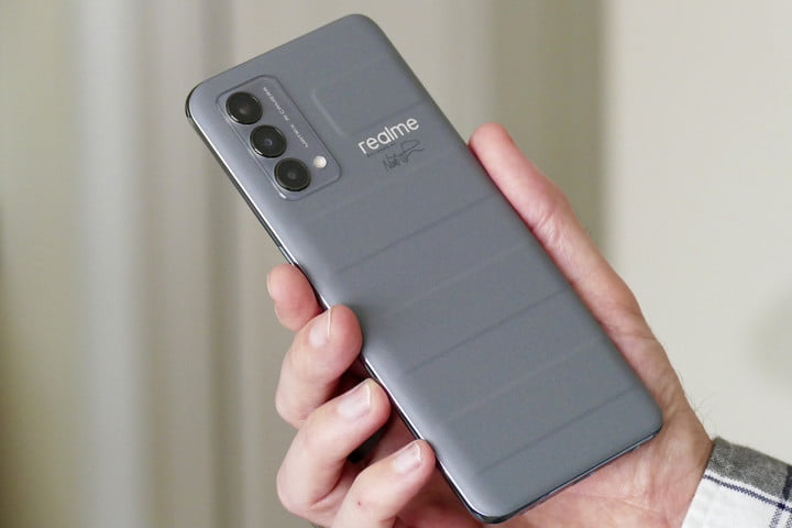 The Realme GT Master Edition in grey vegan leather seen from the back.