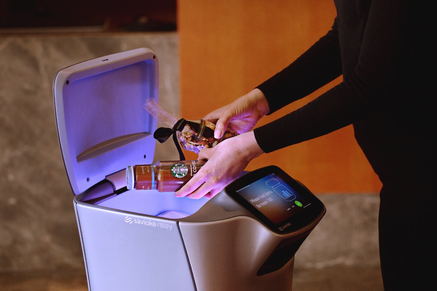 luxury apartment robot butler relay being loaded