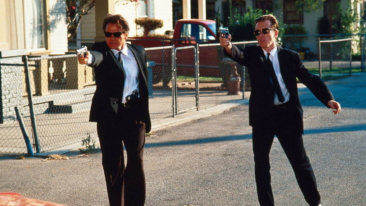 Harvey Keitel and Tim Roth in a gun fight in Reservoir Dogs.