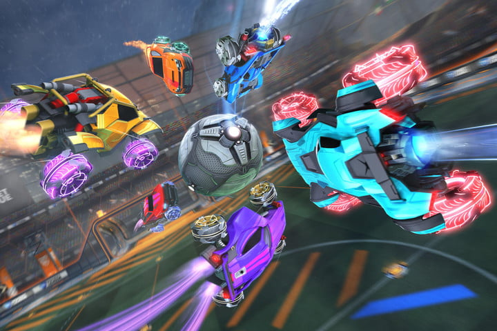 Six cars dive for the ball in a Rocket League match.