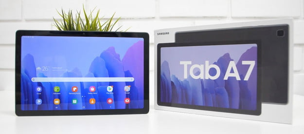 samsung galaxy tab a7 tablet with home screen open on a white brick wall background