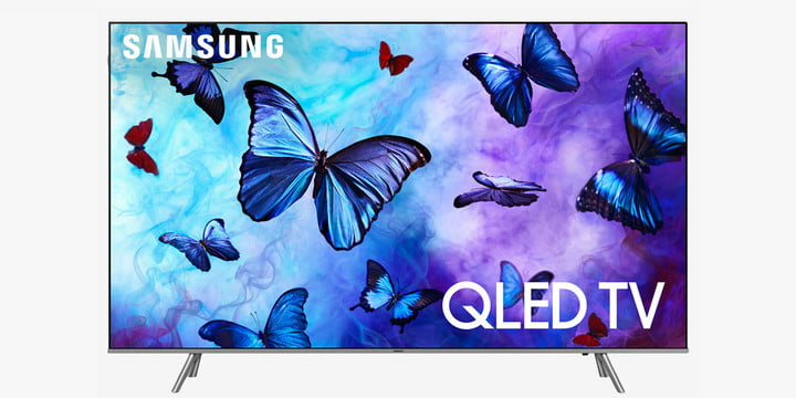 A QLED TV with purple and blue butterflies on the display.