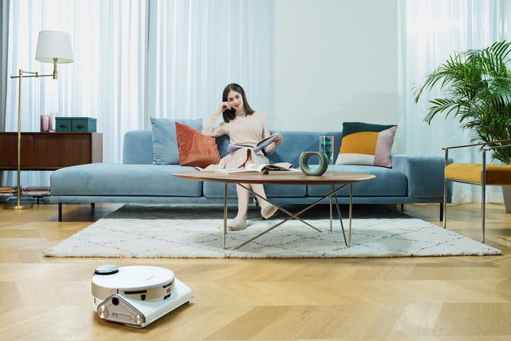 The Samsung Jet Bot cleaning in a living room.