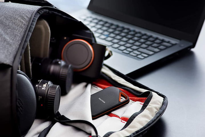 The SanDisk Extreme Pro 500GB sticking out of a photography bag in front of a laptop.