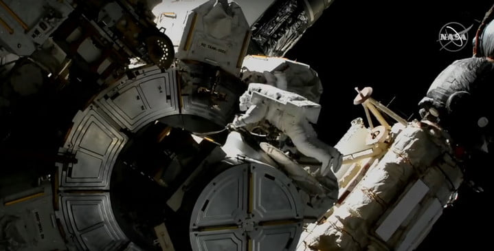 Glover and Hopkins working outside the ISS during their spacewalk on March 13, 2021