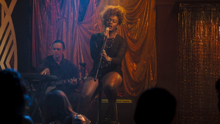 A woman singing in a club on Amazon Prime Video's September Mornings.