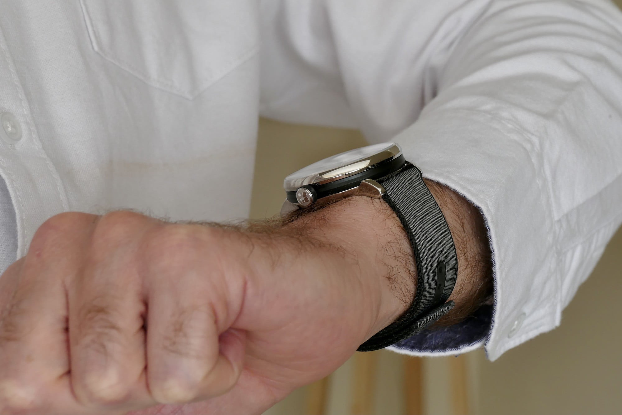 Sequent SuperCharger watch on the wrist showing the side.