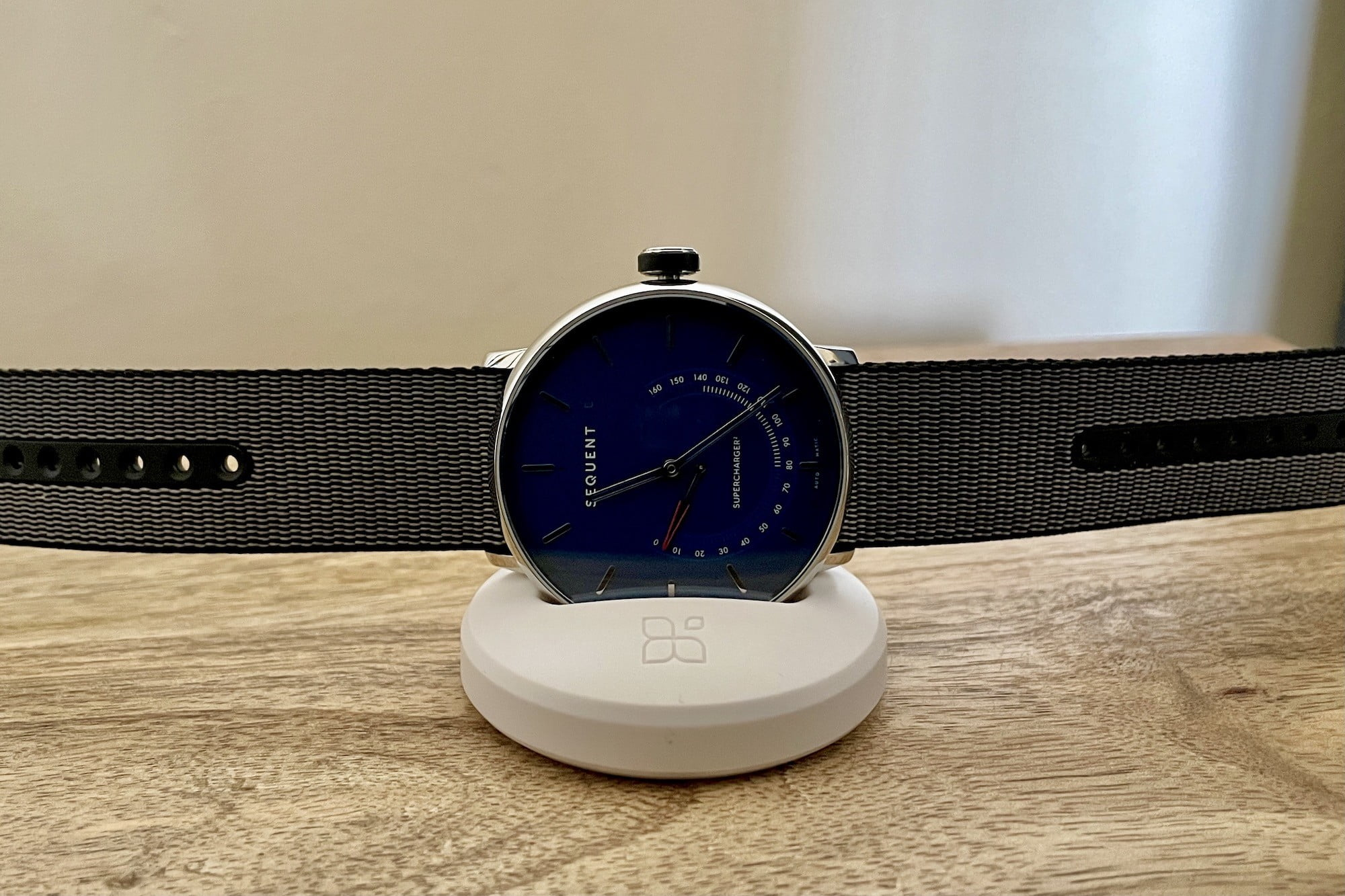 Sequent SuperCharger watch on its charging plinth.