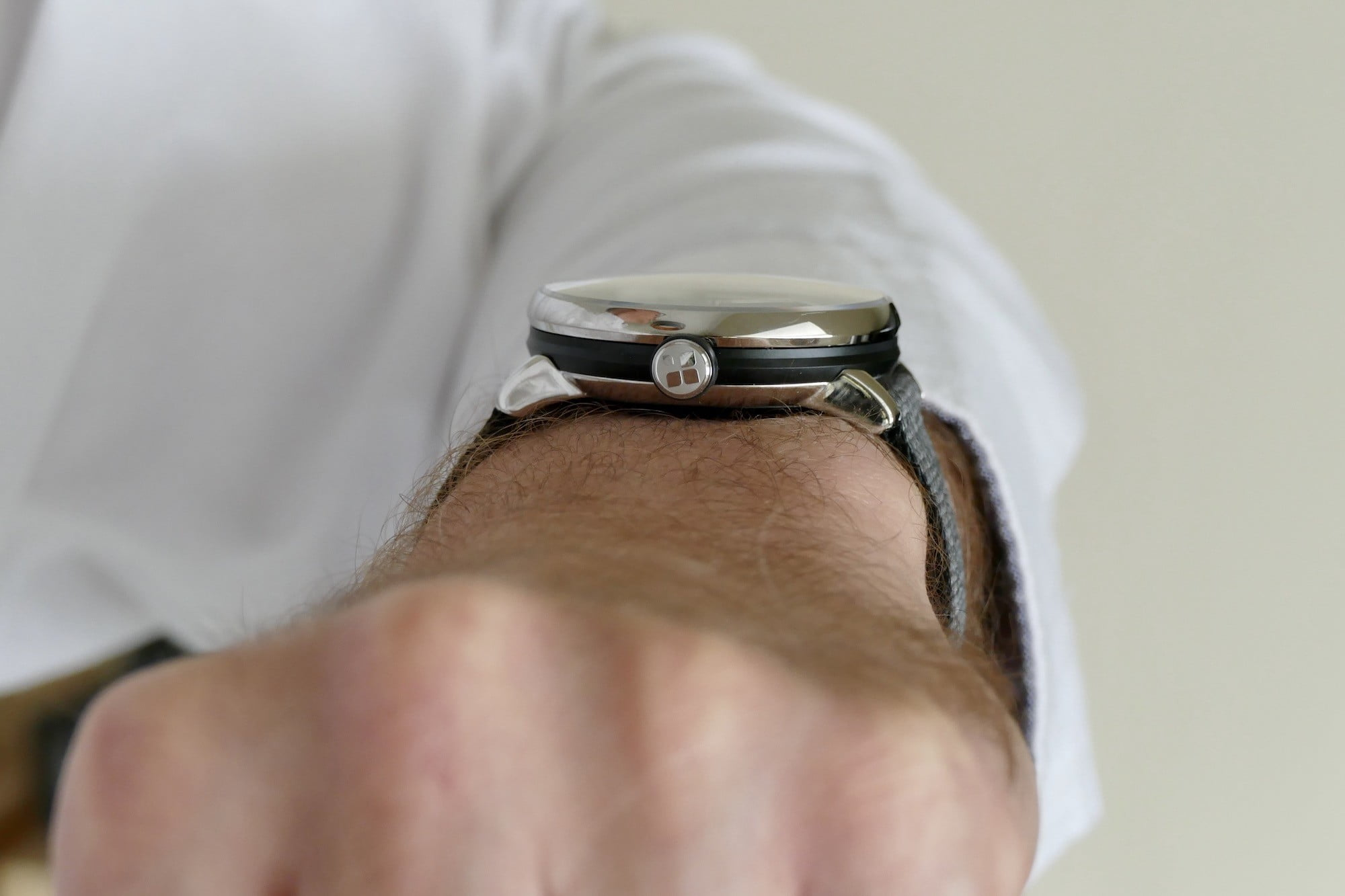 Sequent SuperCharger watch on the wrist showing the crown.