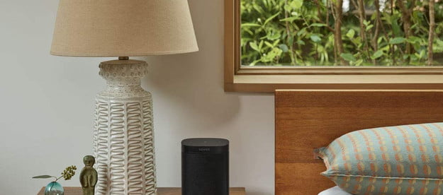 The Sonos One on a bedside table.