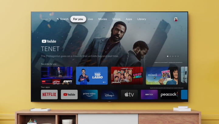 """Sony 55"""" Class X85J Series LED 4K UHD Smart Google TV lifestyle mounted on a yellow wall above living room console table."""
