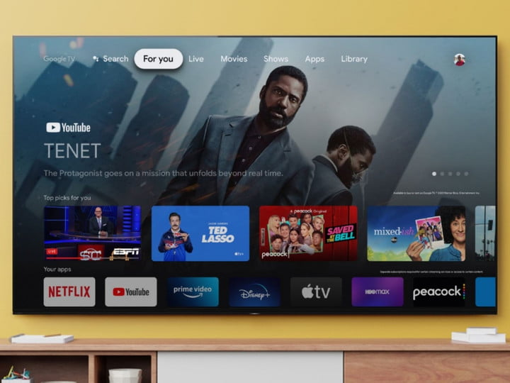 Sony 77-Inch Bravia TV showing home screen apps, mounted on a light brown wall