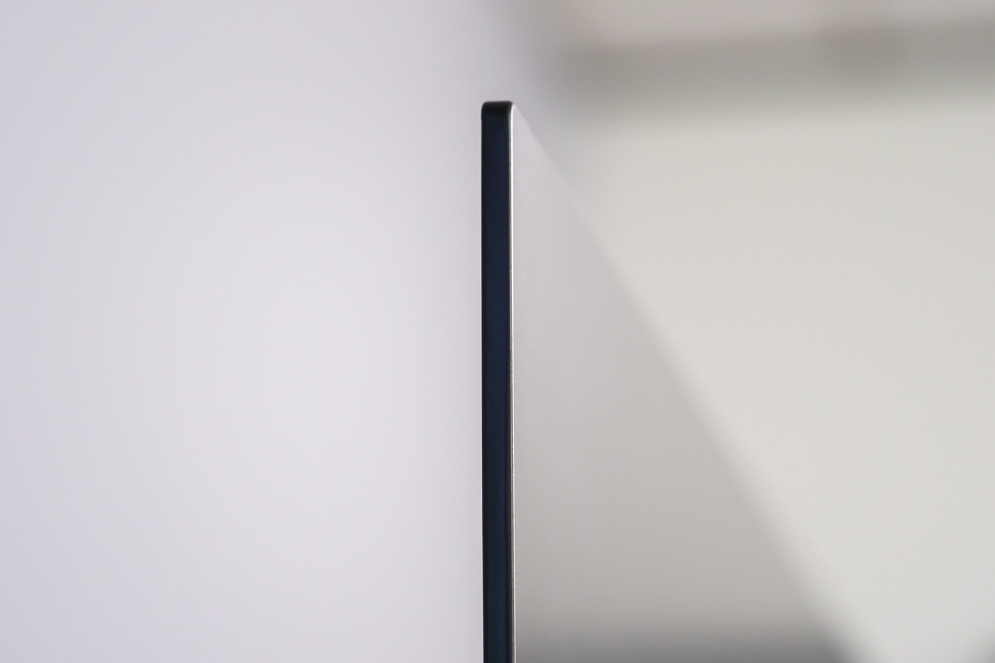 A side view of the Sony A80J 4K HDR OLED TV displaying just how thin the tv is.