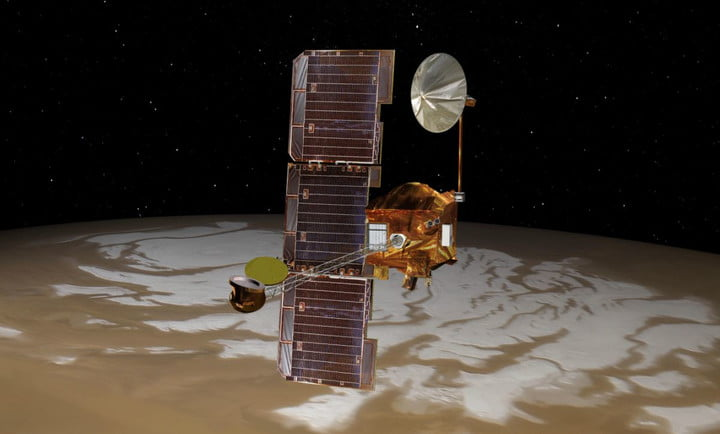 NASA's Mars Odyssey spacecraft passes above Mars' south pole in this artist's concept illustration. The spacecraft launched 20 years ago on April 7, 2001.