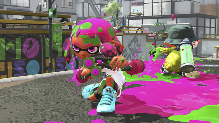 A squid kid crouching with two ink blasters.