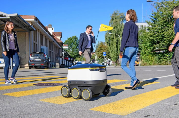 san francisco delivery robot starship on crosswalk with pedestrians