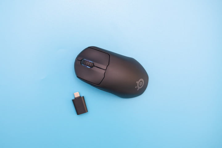 The SteelSeries Prime Mini and dongle on a blue background.