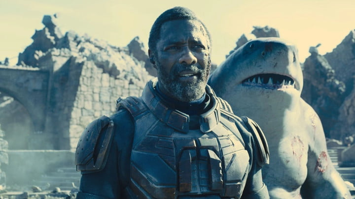Idris Elba as Bloodsport with King Shark standing slightly behind him and to the right.