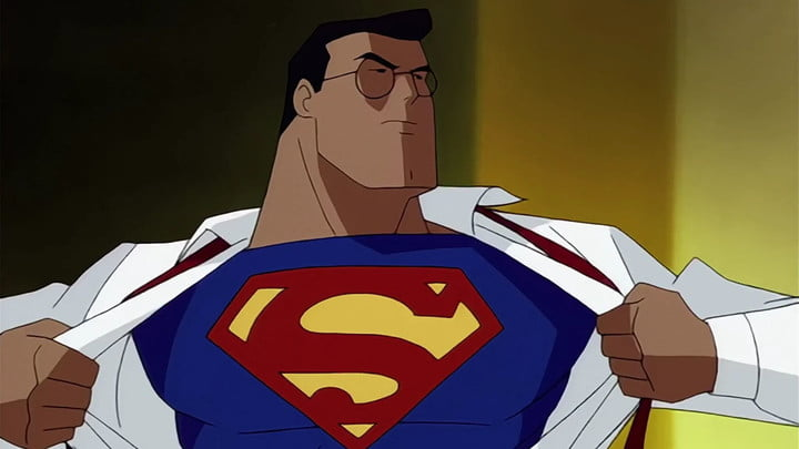 Clark Kent rips open his shirt to reveal the Superman insignia underneath.