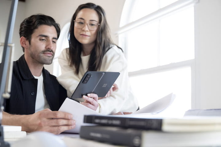 Two people viewing something on the Surface Duo 2.