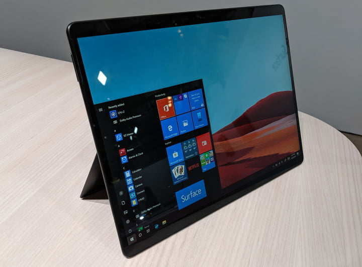 A Microsoft Surface Pro X tablet upright on a table with kickstand out.