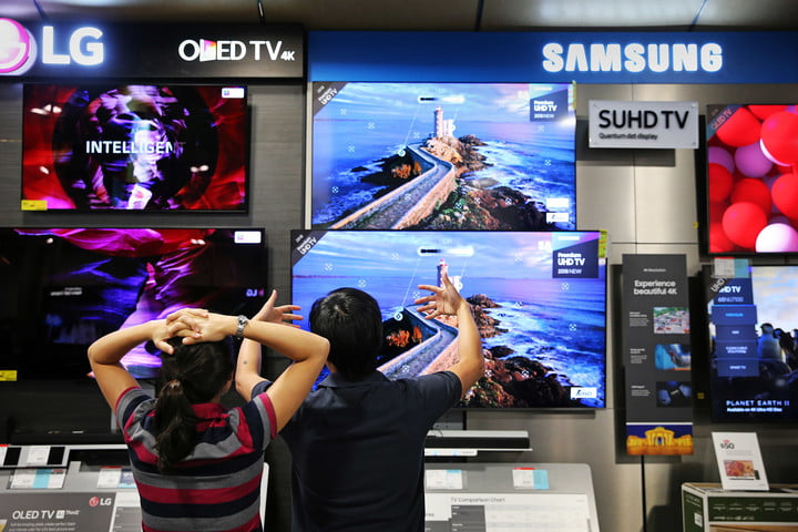 A couple discuss televisions while shopping at Best Buy in the CambridgeSide Galleria in Cambridge, MA on August 11, 2018. Massachusetts shoppers are taking advantage of the tax-free weekend after two years without.