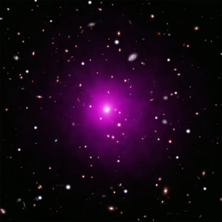 This image of Abell 2261 contains X-ray data from Chandra (pink) showing hot gas pervading the cluster as well as optical data from Hubble and the Subaru Telescope that show galaxies in the cluster and in the background.
