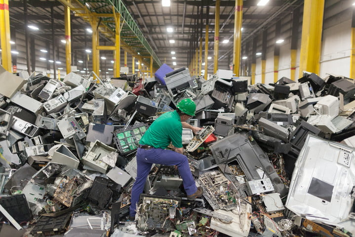 A man standing in e-waste