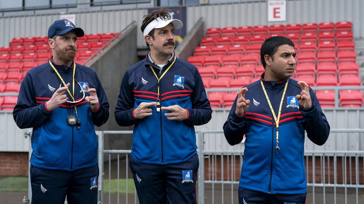 Ted Lasso and his assistant coaches on the sidelines of season 2 of the Apple TV+ original series.