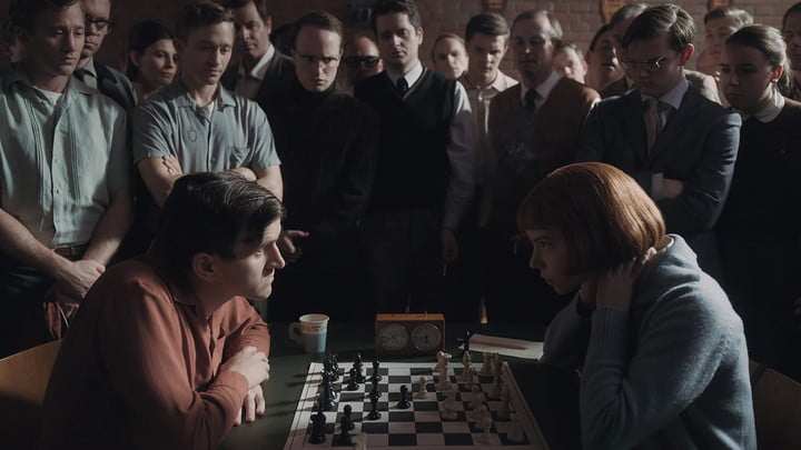 Two people play chess in The Queen's Gambit on Netflix.