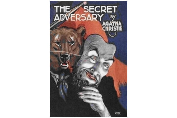 Picture shows the book cover with the title and author name at the top and an illustration of somebody in a suit dressed as a bear, holding a creepy mask