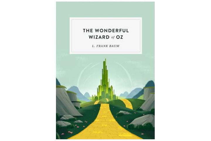 Photo shows the book cover of The Wonderful Wizard of Oz, with the yellow brick road leading towards the emerald city. The book title is written in large black letters and the author's name is in smaller letters beneath it