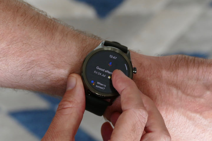 A man engaging with Google Assistant on the TicWatch C2 Plus.