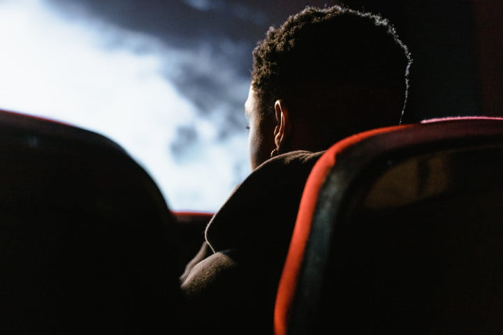 A photo of someone watching a movie in a theater.