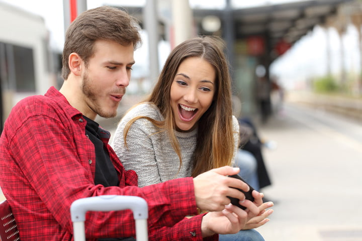 couple smiling at phone