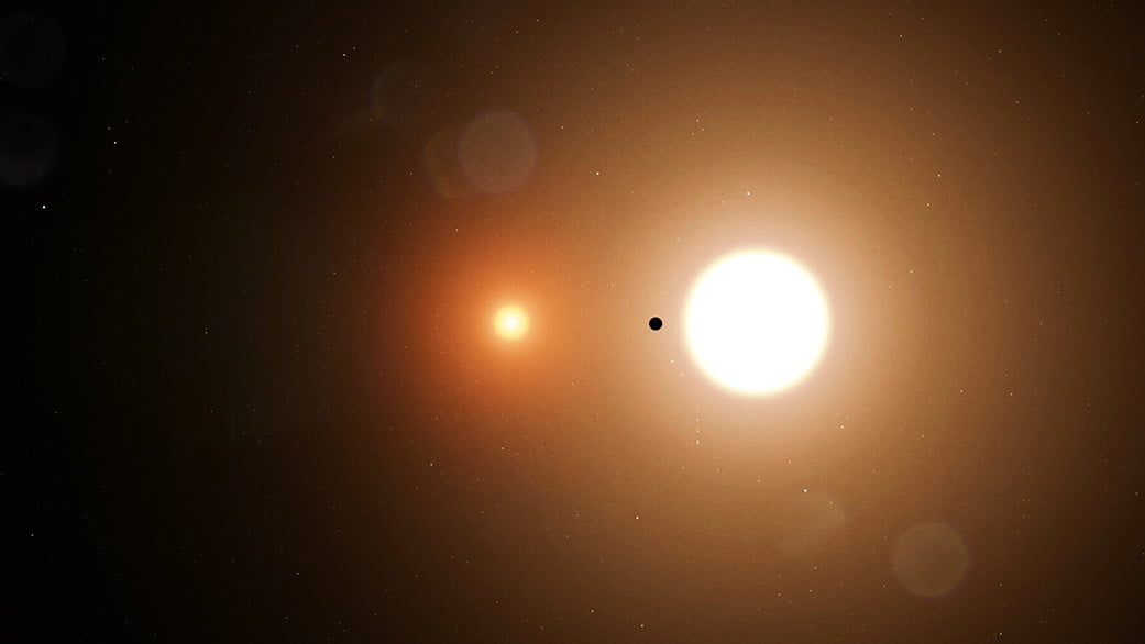 An illustration of planet TOI 1338 b silhouetted by its host stars.