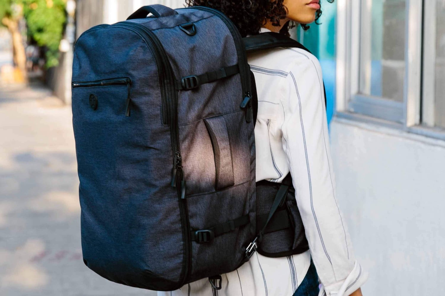 The Tortuga Setout backpack worn by a woman.