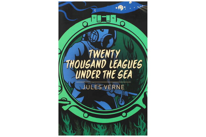 Photo shows the book cover with a green porthole window on a darker background. Through the window you can see a figure in a diving suit in blue, and there's white text with the book's title and author name