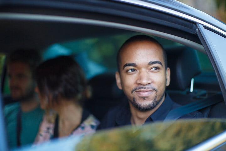 uber promotes multiple transportation solutions uberpool man looking out