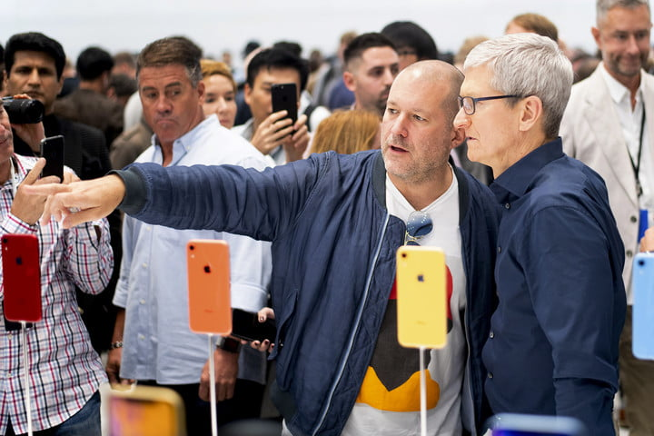 Jony Ive (left) and Apple CEO Tim Cook look over iPhones during a launch event leading up to the release of the iPhone X, XR, and XS.