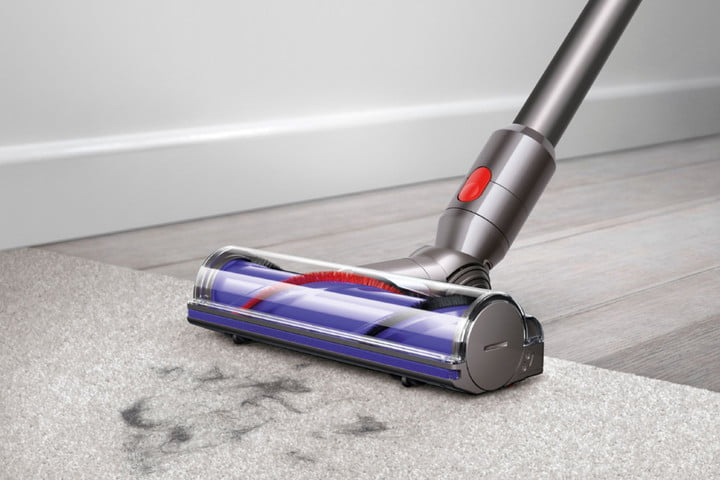 The Dyson V7 Animal cordless vacuum picking up dirt from the floor.