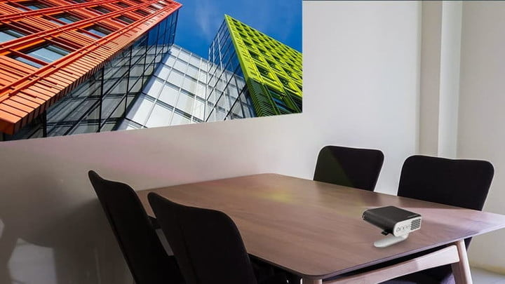 ViewSonic M1 portable business projector on a boardroom table.