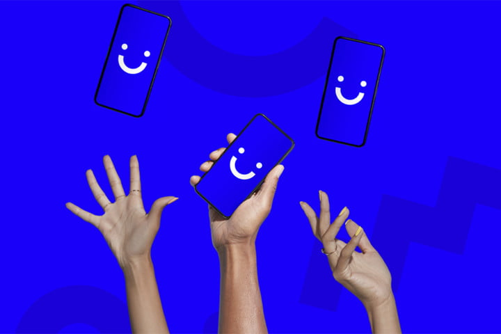 Three hands reaching upwards toward phones with the Visible smiley face logo displayed.