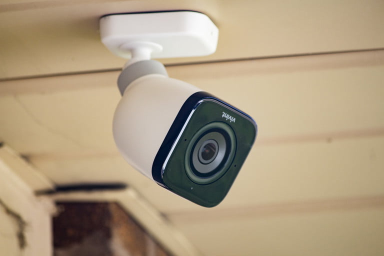 Vivint outdoor camera fashioned to surface outdoors.