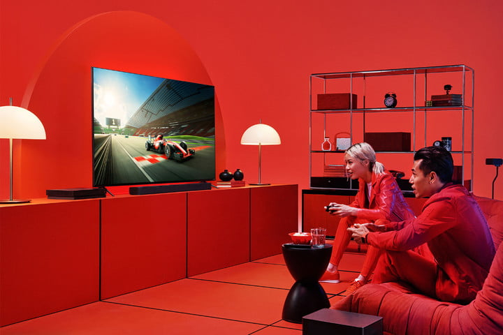 A red room with people playing video games.