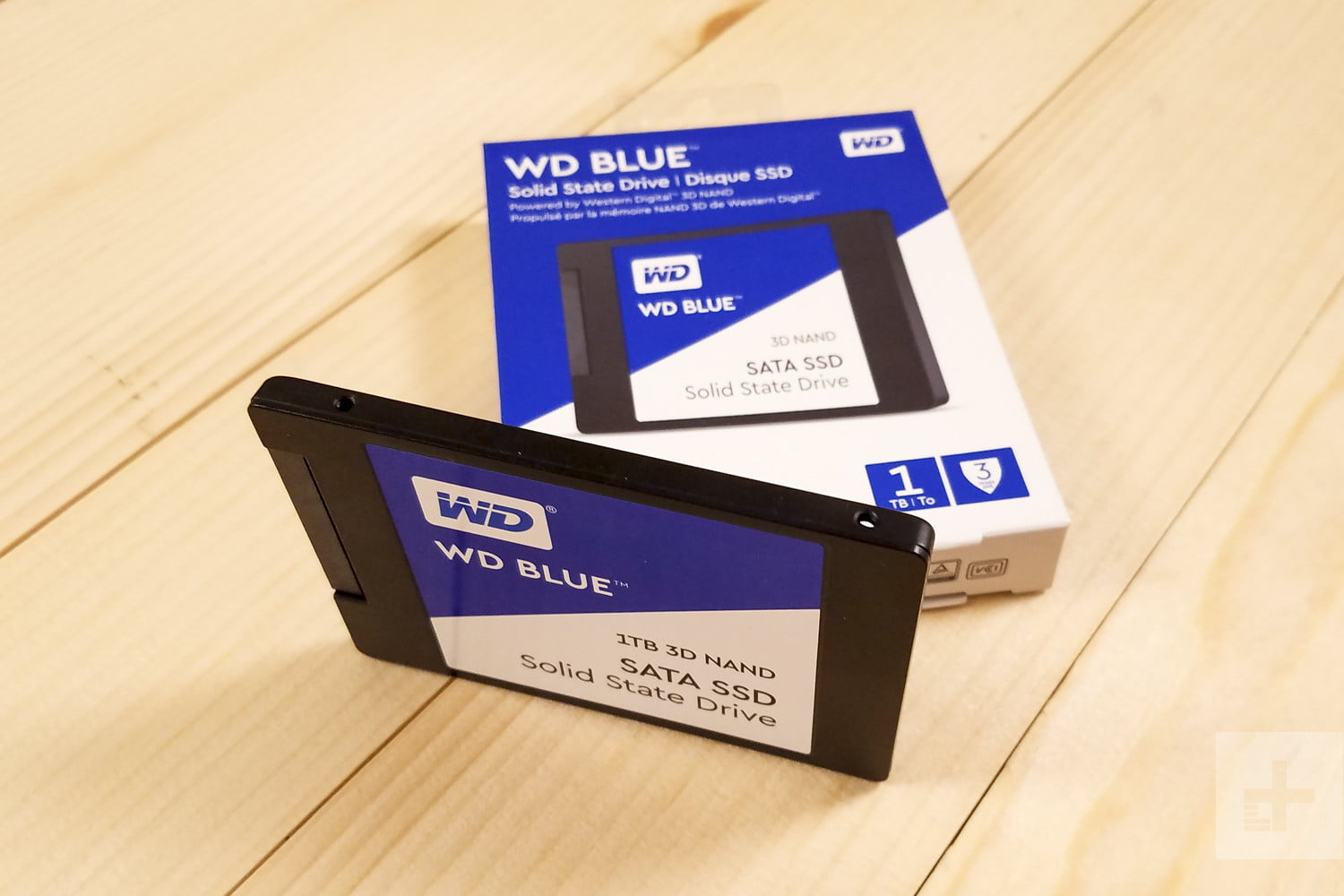 Western Digital Blue 3D NAND SATA SSD sitting next to the box it comes in