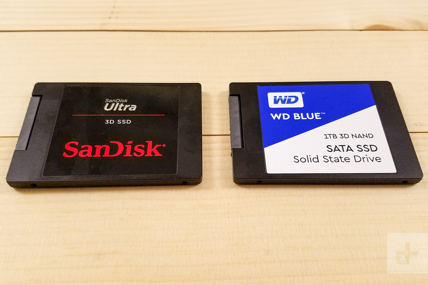 WD Blue 3D NAND SATA SSD and SanDisk Ultra 3D SSD sitting side-by-side aligned horizontally