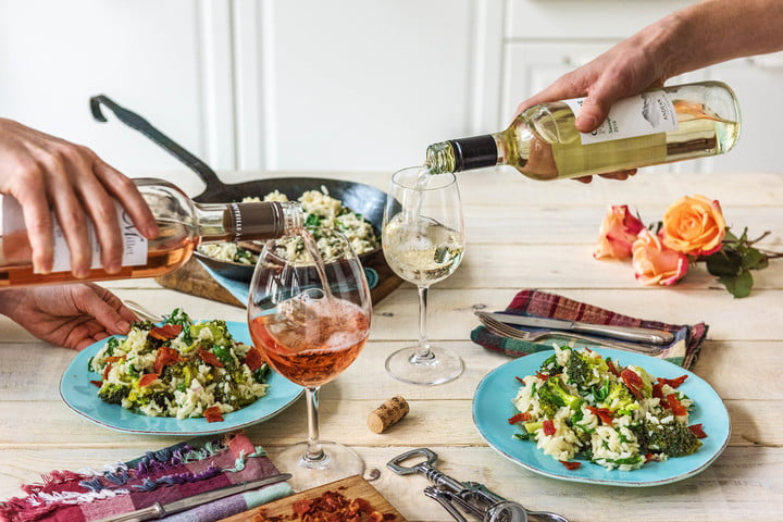 hellofresh wine delivery banner gradient glasses  people cooking cheering cheers fun couple red white rose