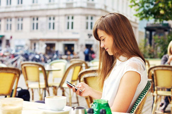 eno capital one woman texting on smartphone