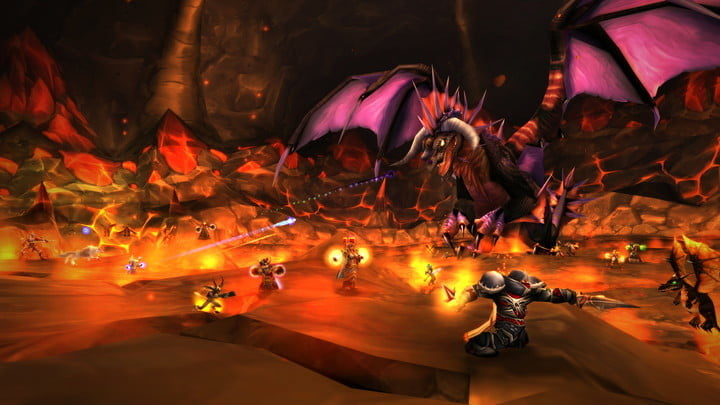 A team of players fighting a dragon in World of Warcraft.